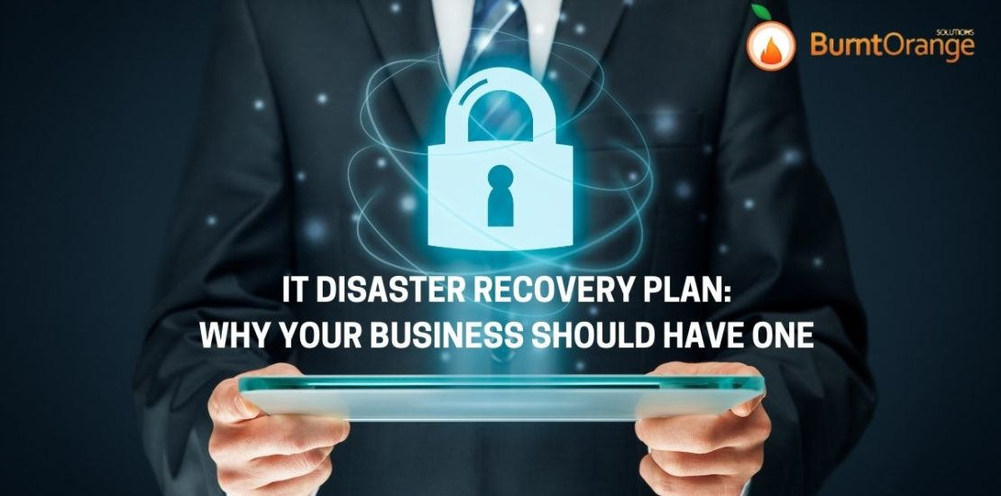Man holding IT recovery plan for his business